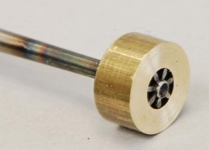 The brass bushing helps make sure that the pinion will not split as I work on inserting the pivot.
