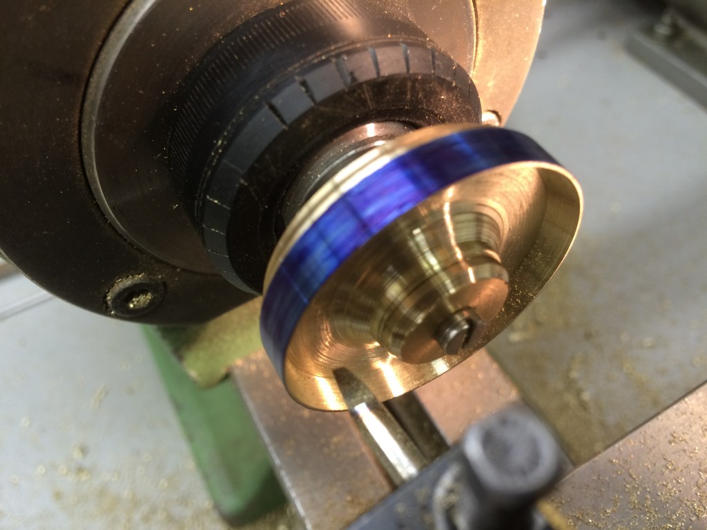 Cut the disc to diameter and hollow out the middle.