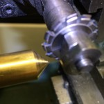 Align the pinion cutter by cutting a slot in the top of a brass cone.  Then turn the cone 180 degrees and cut again.  If the slots line up perfectly, you are ready to cut the pinion leaves in steel.