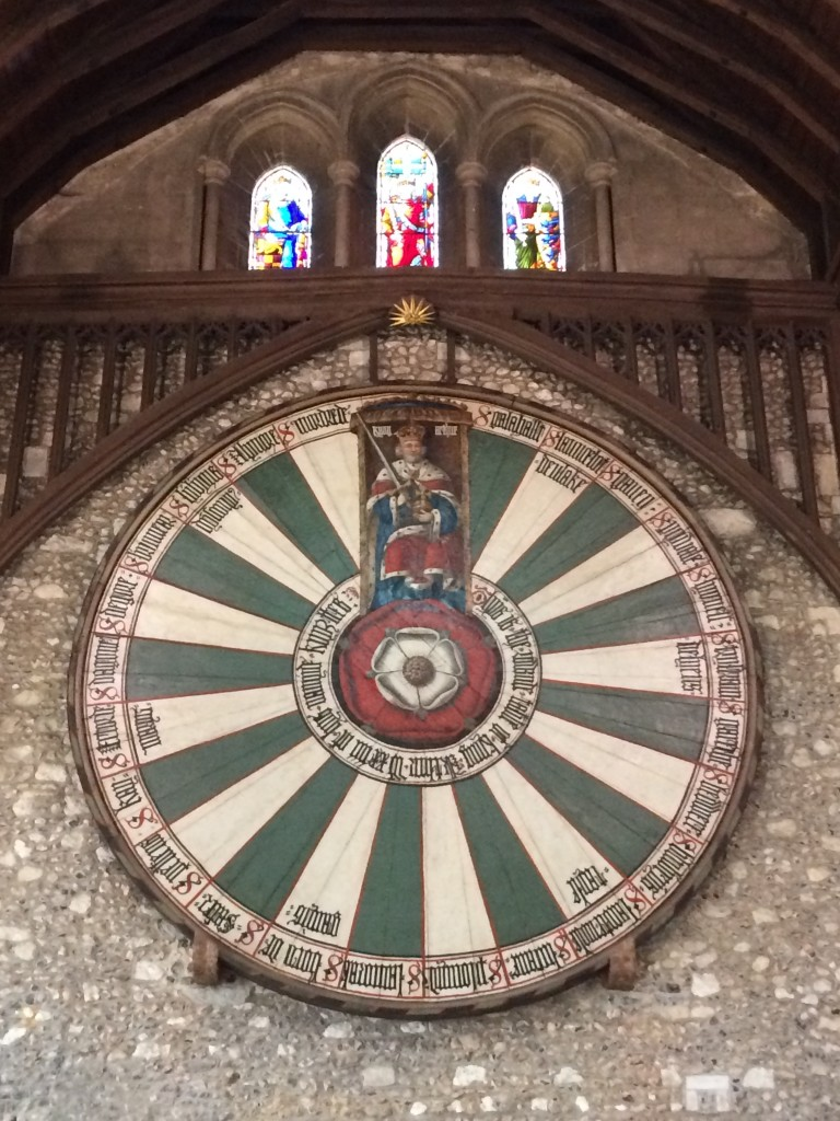 The round table with King Arthur on top and the names of 24 knights written around the perimeter.