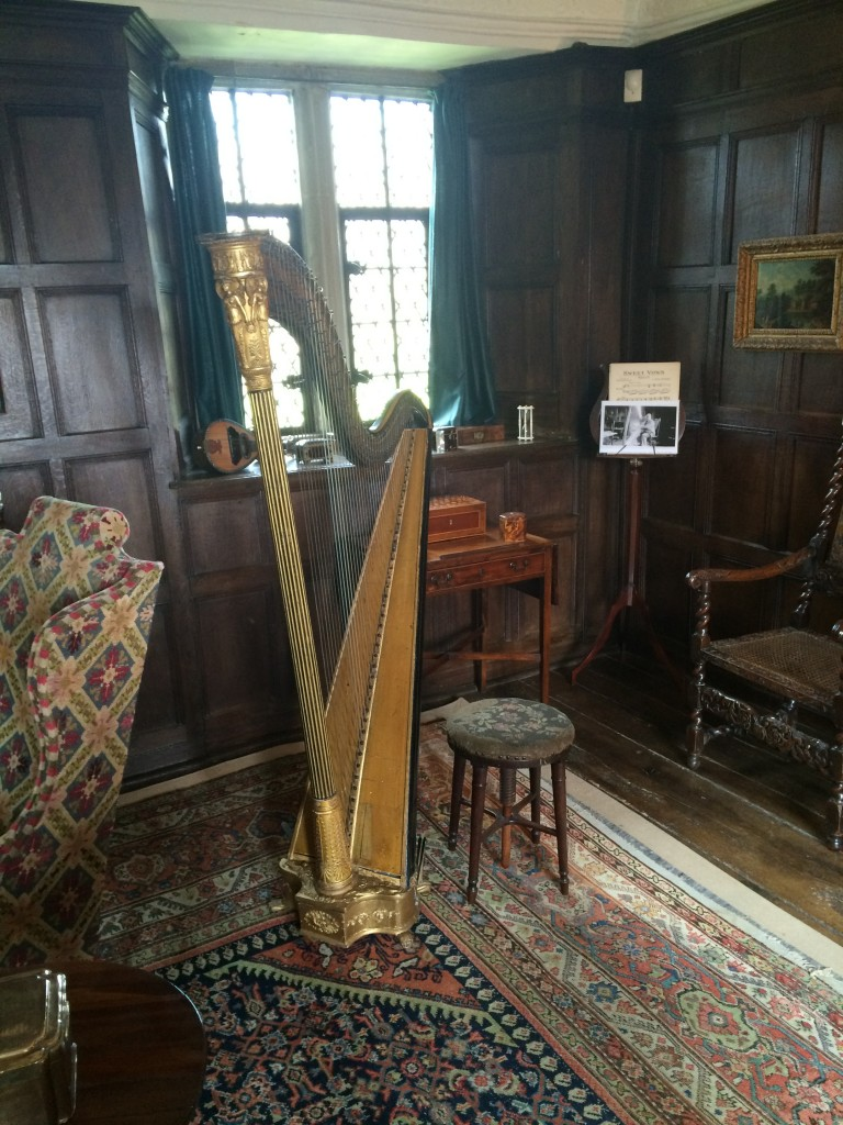 A gilded harp is a lovely addition to the room.