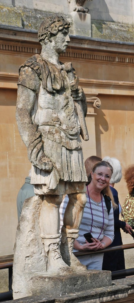 "Debbie stands next to a one of the statues, a ""family friend"", Hadrian."