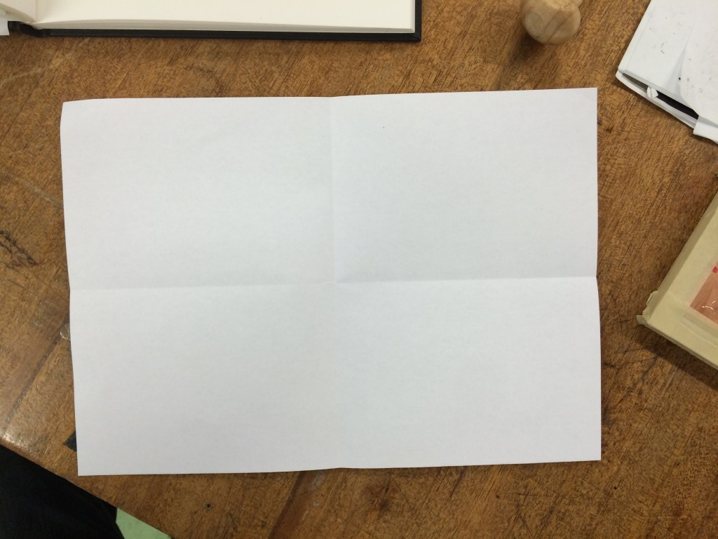 Fold the paper in half both ways.