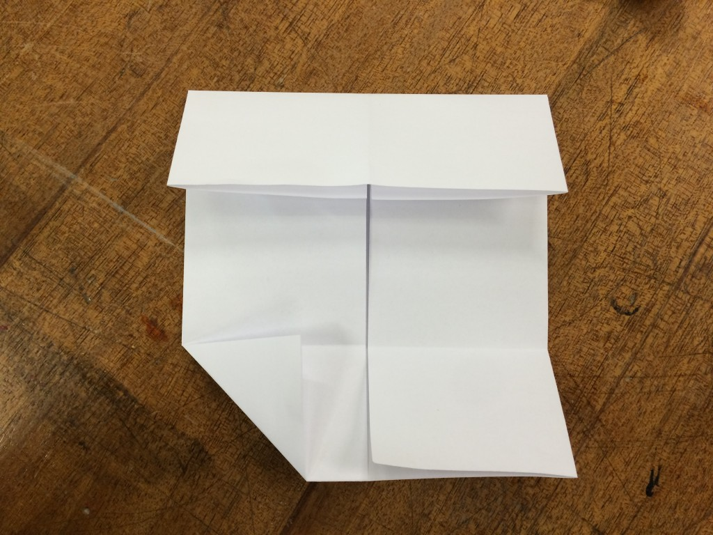Fold the corners in like this.