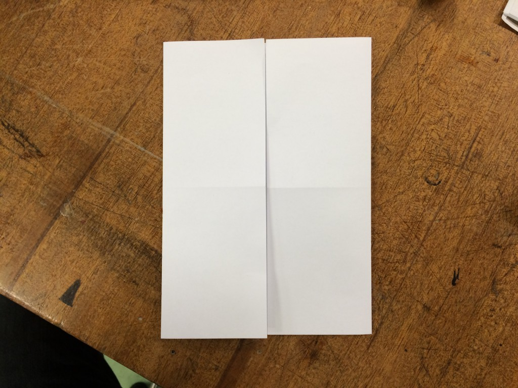 Fold the left and right ends in to the middle.