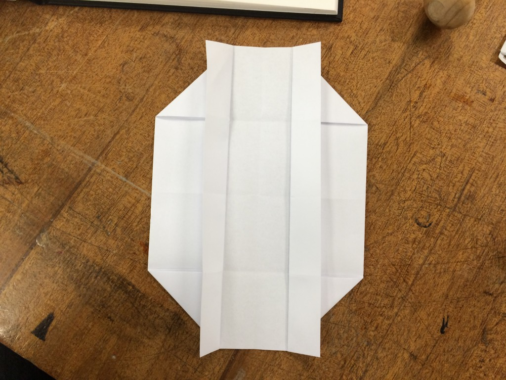 Fold the center flaps over the corners.