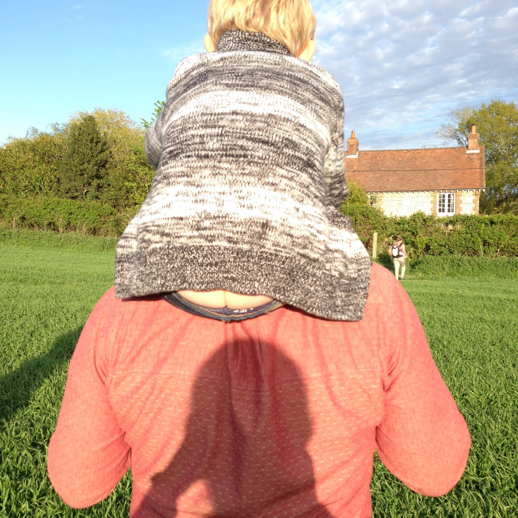 Owne rides daddy's shoulders during a casual walk in the fields near the Orchard Barn.